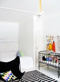 Black & white nursery with pops of colour.