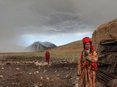 After a hailstorm, nomadic Kyrgyz girls venture outside their mud hut beside the Aksu River in a remote part of Afghanistan. The nomads sometimes stop here for a few weeks between migratory seasons if grass for their herds is too scarce at the summer or winter camps.