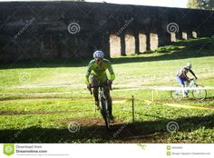 Cyclo cross competitors taking part in a race in Acquedotti in Cinecitta park, Rome, Italy.