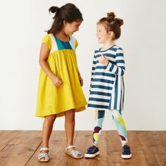"""Aurora is an Italian girl's name that means """"dawn."""" This dress is a pretty pick for your little ray of sunshine."""