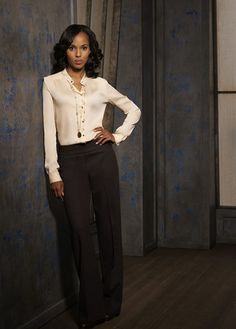 Olivia Pope in a cream silk button down.