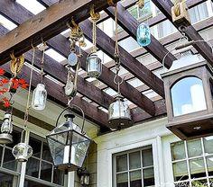 DIY nautical lantern idea with rope and pulleys!  http://www.completely-coastal.com/2015/05/diy-coastal-beach-summer-lanterns.html
