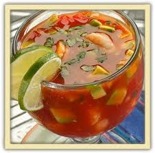 Mexican Shrimp Cocktail--is a large scale appetizer served in only your best or hole in the wall traditional Mexican resturants.. I call it shrimp cocktail on steroids, it has tomatoes, shrimp, avacado, onion and bits of cucumber in a spicey tomatoe sauce which is great with corona beers and lime.. don't forget to order fresh corn tortilla to add to the flavor..