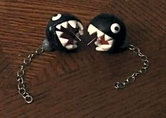 Biting Chain Chomp Stud Earrings. $23.50, via Etsy.