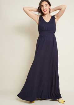 Clad in the unique effortlessness of this navy maxi dress, your vibe embodies goddess on lock! Tied shoulders on either side of this knit number's...