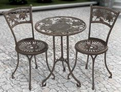 Whitehall Monogram Vineyard Bistro Set - Oil Rubbed Bronze by Whitehall. $589.99. Material: Aluminum and Glass. Includes: Bistro Table & Bistro Chairs. Table: 22 L x 22 W x 28 h inches. Chair:15 L x 15 W x 33 H inches. WHAT'S INCLUDED: One Bistro TableTwo Bistro ChairsModeled from age-old grapevines and leaves, these high-relief tabletops are a perfect companion to a glass of wine on the patio. As the rich detailing and elegant finishes blend together, they create the perfect...