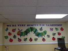 "Eric Carle's 'The very hungry caterpillar' themed class picture wall. ""We're very hungry for learning!"" Pre k classroom Hungry Caterpillar Classroom, Caterpillar Preschool, Very Hungry Caterpillar, Eric Carle, Classroom Decor Themes, School Decorations, Classroom Ideas, Classroom Posters, Classroom Design"