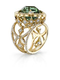 Erica Courtney Empress ring.... With that beautiful bi- symmetrical cut tourmaline matching the earrings.... Love this stone!