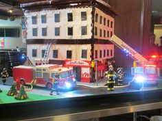 Cake Boss cake: the Fire Trucks have flashing lights and sirens. The ladder has a hose that shoots water out of it and Buddy was to light the cake on fire! Cake Boss Buddy, Cake Boss Tlc, Buddy Valastro, Cute Cakes, Pretty Cakes, Cake Cookies, Cupcake Cakes, Fire Cake, Carlos Bakery