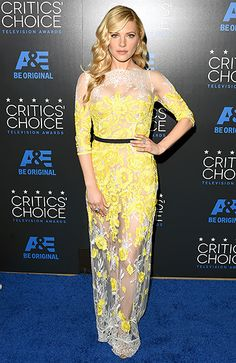 The blonde beauty worked a sheer lace dress, strategically embellished with lemon-hued posies.