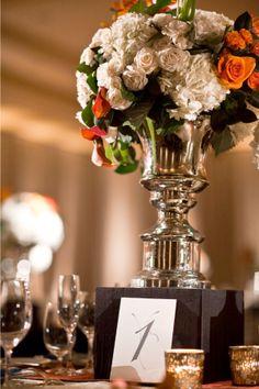 Raised vase (this wedding also has lamps around the ballroom)