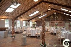 Winter rustic wedding decorations and fairy lights at Owen House Barn - Laurel Weddings
