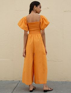 This cute orange smocked jumpsuit with puff sleeves is like wearing pure sunshine. Discover casual summer outfits and runway ready styles at Pixie Market. Casual Summer Outfits, Wide Leg Pants, Smocking, Cute Dresses, New Dress, Legs, Pixie, Sleeves, Model