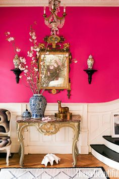 Hot pink walls bring a playful contrast to the exquisite antiques in this late-19th century Brooklyn townhouse by Jonathan Berger.
