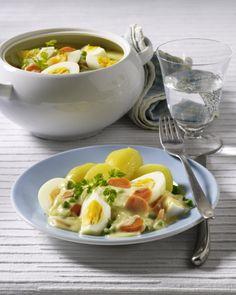 Unser beliebtes Rezept für Senf-Eierragout mit Erbsen und Möhren und mehr als 55.000 weitere kostenlose Rezepte auf LECKER.de.