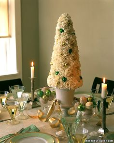 Using carnations to evoke a snow-covered tree, this centerpiece transforms the tabletop into a fanciful winter garden.