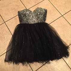 Semi-formal or cocktail dress!! Super sexy, strapless, short party dress. Could be worn to a formal event, wedding, prom, or cocktail party..  Black with silver rhinestones and sparkles in the skirting. Dresses Strapless