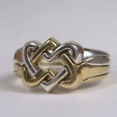 Hey, I found this really awesome Etsy listing at https://www.etsy.com/listing/216799276/celtic-hearts-puzzle-ring-in-sterling