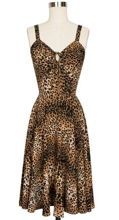 Timelessly stylish and elegant, Trashy Diva's 1940s and 1950s inspired Leopard Collection is making its debut in our luxurious rayon crepe de chine in new and classic styles. You're sure to love the easy fit of the '50s style L'Amour Dress in our favorite animal print. The bust of this vintage-inspired dress gathers to the center with a dainty drawstring keyhole front to create the retro look we all love. The bodice features stretchy sides similar to the Trixie Dress with elastic ruching…