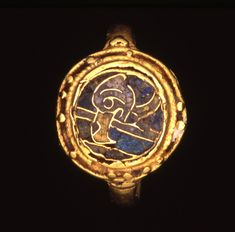 Late Anglo-Saxon, 9thC(late)-11thC. Gold finger-ring: an eagle design on the bezel in yellow, blue and purple cloisonné enamel, surrounded with pellets.