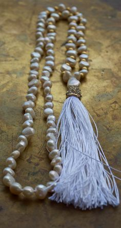 Gorgeous, super luxe gold and white pearl bohemian necklace from Pillow Book Design