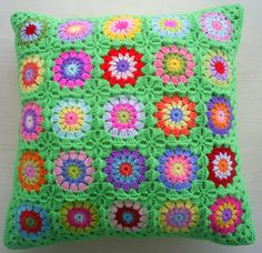 25 different colors in a lovely grass green edging. The cover measures about 45 cm in square. There is a matching lovely embroidered fabric on the