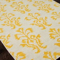 Sunny Ikat Damask Dhurrie Rug  This bright Ikat design in yellow and white makes a happy rug for any room! Reversible 100% wool dhurrie flatweave construction. Imported.  (Specify size and color when ordering)    Product SKU: XR13020 0203YE  Price:  $79.00