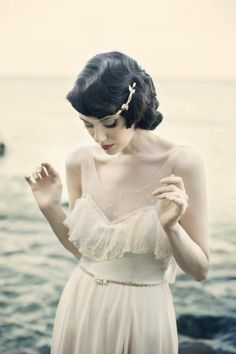 classic vintage hair style with a fabulous hair pin, with a simple vintage gown perfect for a late afternoon beach wedding.. so romantic