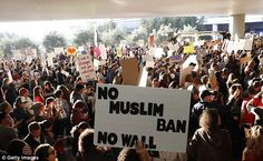 Demonstrators block traffic at the international arrival terminal as they protest against muslim immigration ban at San Francisco International Airport