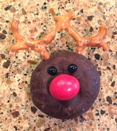 Reindeer Pretzel....do a larger version using choc. covered donuts for a fun breakfast treat!!!!