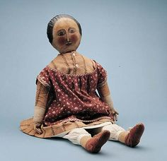Photograph:The American cloth doll of 1890–1900 is entirely handmade, with hand-painted face and features.