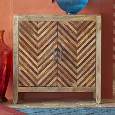 Hindu philosophy teaches that all is illusion (<i>maya</i>)—and our fool-the-eye Kadhi Cabinet is a prime example. Handcrafted from native Indian hardwoods, each piece features a bold chevron design that lends a 3-D appearance to door fronts. But inside, two drawers and a shelf provide very real storage space.