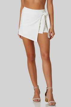 High rise skort with chic wrap over front with ties for closure. Stretchy material with flattering slim fit.
