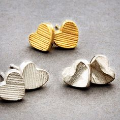 Deep-textured sculptural earrings in solid gold and silver from Latham & Neve's Dune collection.