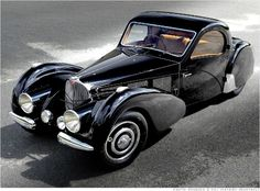 """1937 Bugatti Type 57SC Atalante  The S in F7S stands for surbaissé or """"shallow."""" The car's frame was designed so that the 200-horsepower 3.3-liter supercharged 8-cylinder engine was mounted as low as possible in the car. That gives the car a low center of gravity for cornering, but also allows the long hood to sink down between the huge, swooping fenders."""