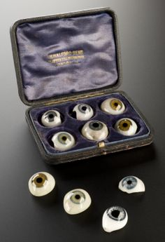 Ten assorted artificial eyes, London, England, 1870-1920 -- These make me think of industrial accidents in unsafe factories and of the blasts of WWI.  That makes me sad.  Then I think how grateful the person must have been to receive the restored image that these beautifully-crafted eyes must have offered.  People helping people makes me happy.