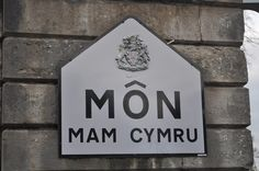 Translates to Anglesey, mother of Wales for the fact that at one time it fed the rest of Wales due to the pasture of the land