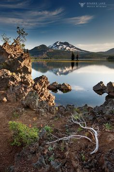 Sparks Lake by Marco Milanesi. Sparks Lake is a lake in Deschutes County, Oregon. Many of Deschutes County's other natural sites can be seen from the lake, such as Mount Bachelor. There are seven mountains near the lake including Three Sisters, Broken Top and Mount Jefferson.