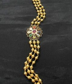Gehna ofer to sell A 'navratna' pendant forms a decorative clasp for this multi-stranded handcrafted 22k gold beaded mala online in Chennai.