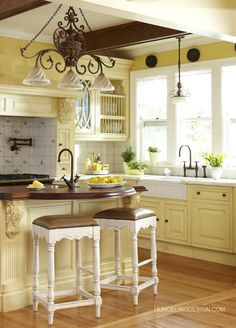 Butter yellow French country kitchen... I found these gorgeous corbels on Amazon for $14 each; they're from Ekena Millwork and are high-density urethane, not wood, and can be used on the outside as well as the inside.
