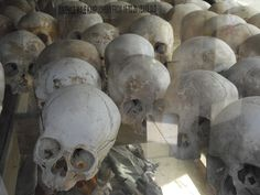 The Killing Fields, 15 kilometers from Phnom Penh, Cambodia. It's a monument unlike any in the world - crammed with skulls and other bones unearthed from just one of the hundreds of Cambodian Killing Fields. The government chose to leave most mass graves alone, so this is both cemetery and hallowed ground.