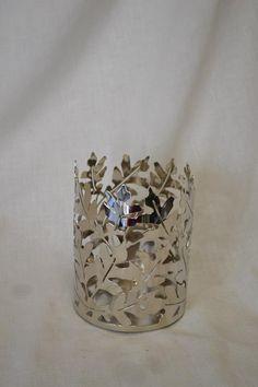 Unique vase or candle holder. Fleurish Floral Designs