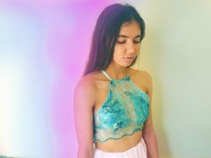 This is a delicate sheer ocean blue lil number.Fits size 6-10 with an adjustable back that does a criss cross and ties up