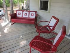 Fabulous red and white vintage metal chairs and glider.