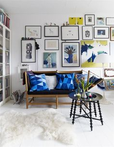 Blue and Yellow accent the theme tied through artwork and pillows