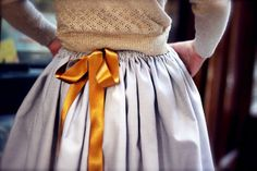 Light blue satin skirt with contrasting ribbon   via Eclecchic: Inspiration