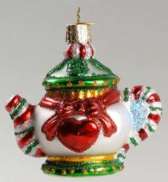 Merck Family's Old World Christmas Holiday Teapot teapot shape Christmas tree ornament ... red heart and bow on silver, candy cane stripe spout and handle, c. 2000- 2015, blown glass