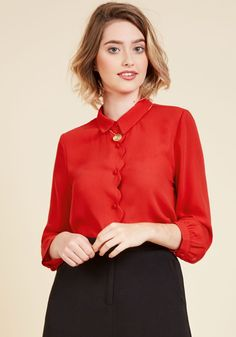 This fiery red blouse introduces a look into your aesthetic that's fittingly vivacious, but in a new and novel way! Stemming down from its collar, a scallop-edged button placket offers elegant allure, while subtle side vents and 3/4-length sleeves are sweetly sophisticated. What a chic find!