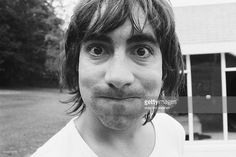 The Who's drummer Keith Moon puffing his cheeks out.