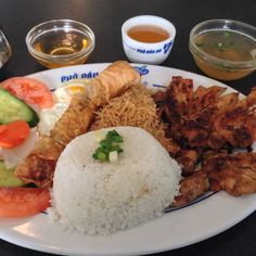"My ""usual"" at Pho Dau Bo. Pork chop, chicken, steamed rice, spring rolls, egg."